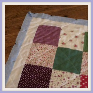 Pinning edging My very first quilt...and I finished it too!