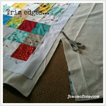 Trim edges How to Make a Cotbed Quilt for Beginners, Step 7: Layering and Basting Your Quilt.