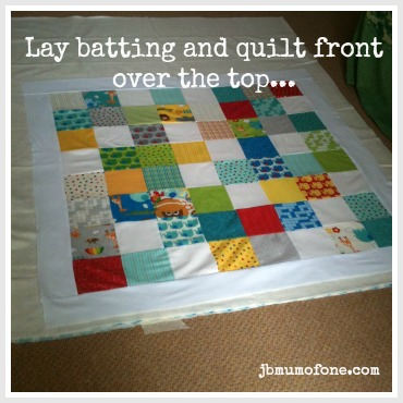 Layer batting and front of quilt