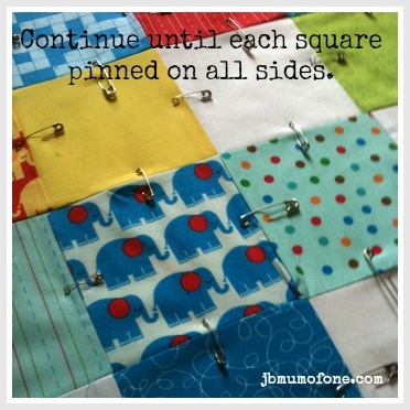 pin all squares How to Make a Cotbed Quilt for Beginners, Step 7: Layering and Basting Your Quilt.