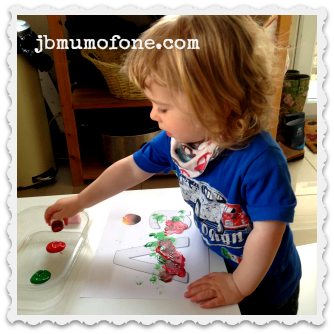 Toddler painting with marshmallows