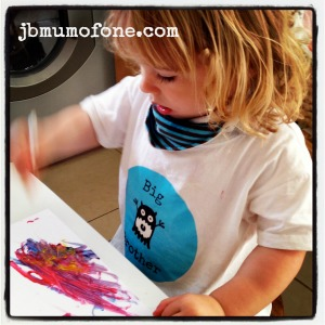 Toddler painting with cotton buds