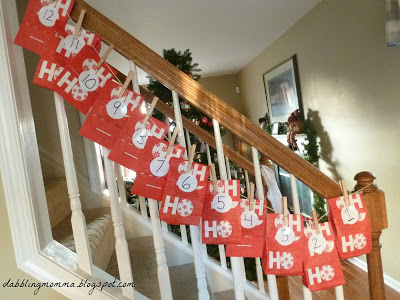 Advent bags hung up on staircase pm