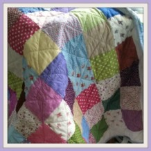 How to Make a Cotbed Quilt for Beginners, Step 3: Sewing an Individual Row of Squares